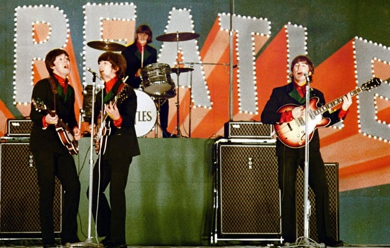 Beatles on stage - world greatest ever band performing