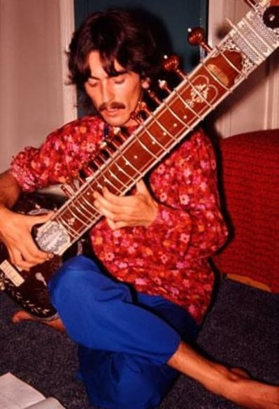 George Harrison playing a sitar - Beatles Forum
