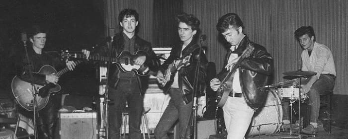 Stuart Sutcliffe, Paul McCartney, George Harrison, John Lennon and Pete Best on stage as The Beatles